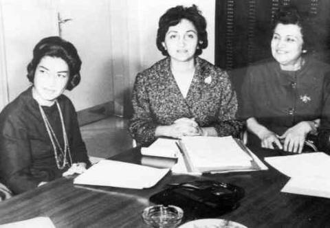 R-L Princess Ashraf and Mehrangiz Dolatshahi at a meeting of the executive committee of the High Council of Women's Organiza