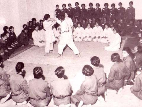 Women Corps Volunteers at a Judo Competition