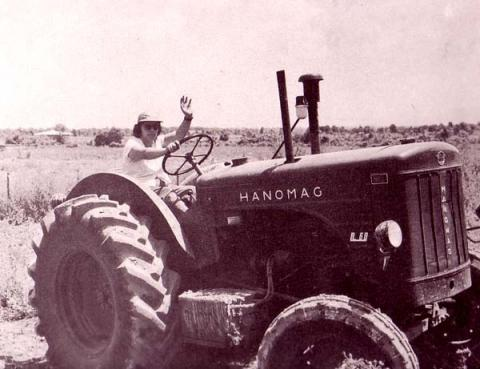 Woman Ooperates Tractor